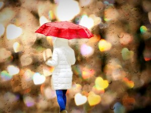 walking in the rain with umbrella