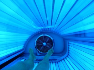 person in tanning machine